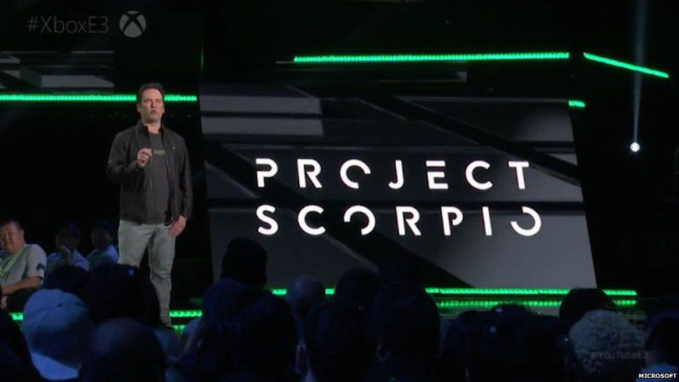 Speaker on stage in front of Project Scorpio sign