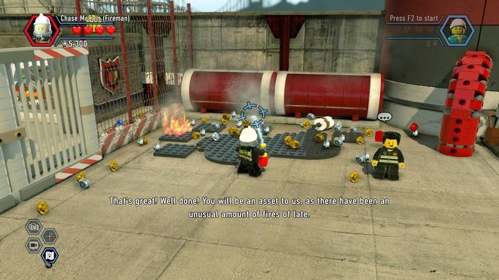 Hold down the attack key to use the extinguisher - Fireman training | Walkthrough - Chapter 10 - LEGO City: Undercover Game Guide