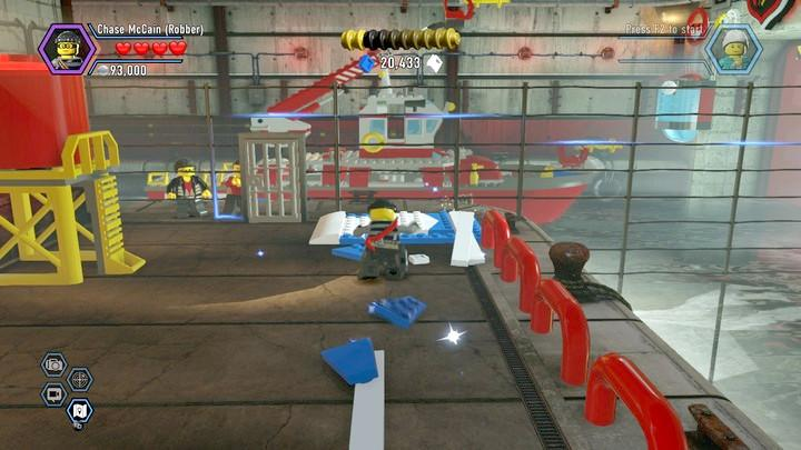 Use the catapult to make it over the water and disable the door blockade. - Fireman training | Walkthrough - Chapter 10 - LEGO City: Undercover Game Guide