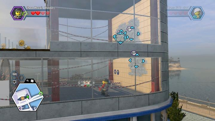 Again, to use the climbing wall, you have to color the white blocks on the wall - Hospital | Walkthrough - Chapter 10 - LEGO City: Undercover Game Guide