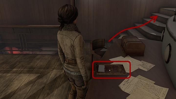 Approach the table found in the southern part of the room (the table is opposite to a stillage with the phonograph) and pick-up Captain Obos log book - Return to captain Obo and convince him to ferry the Jukolians | Chapter three | Walkthrough - Chapter three - Syberia 3 Game Guide
