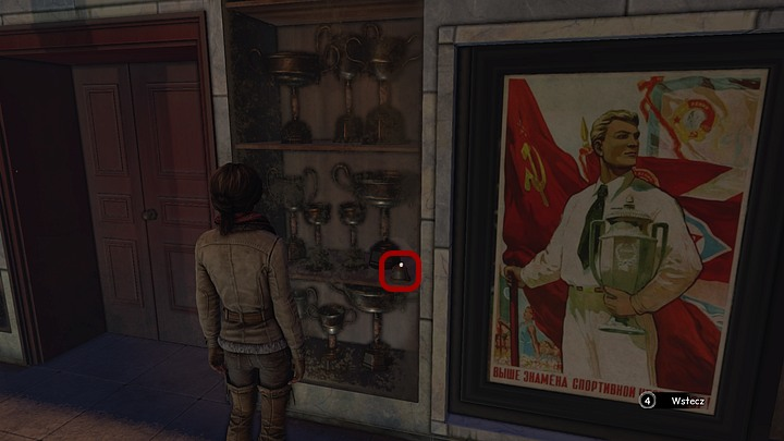 In the room that you enter, look at the display case - right next to the door - Find three Yukol lenses - Chapter seven - Syberia 3 Game Guide