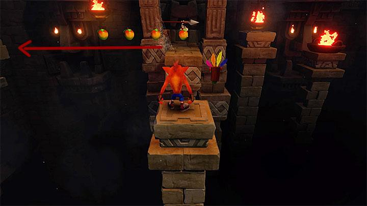 You will need to make your way through another corridor filled with stone blocks coming from the walls - Temple Ruins | Wumpa Island | Levels - Crash Bandicoot - Wumpa Island - Crash Bandicoot N. Sane Trilogy Game Guide