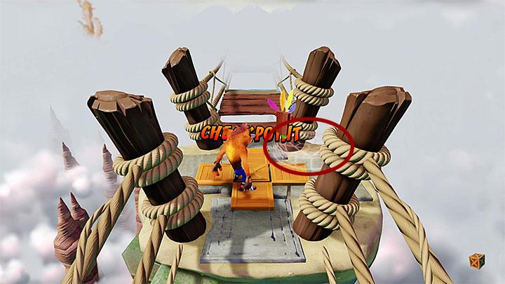 At one point you will reach a wall made of metal crates, two TNT crates and one normal crate - Road to Nowhere | Wumpa Island | Levels - Crash Bandicoot - Wumpa Island - Crash Bandicoot N. Sane Trilogy Game Guide