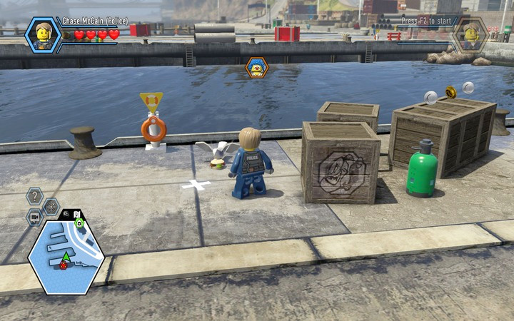 Behind the crates you will find a seagull, that stole the worker�s sandwich - The bank robbery | Chapter 1 - Chapter 1 - LEGO City: Undercover Game Guide