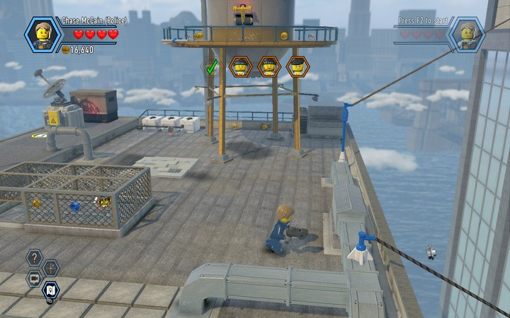 Jump onto the rope to get to the next building - The TV station building | Chapter 2 - Chapter 2 - LEGO City: Undercover Game Guide