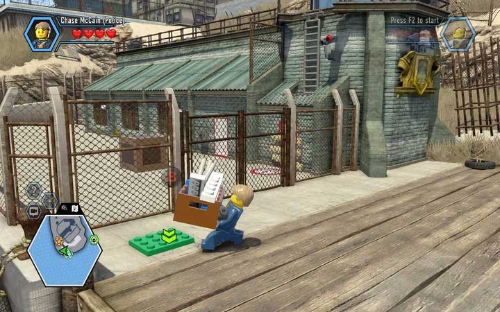Take the box and put it on the green plate - The prison island | Chapter 3 - Chapter 3 - LEGO City: Undercover Game Guide