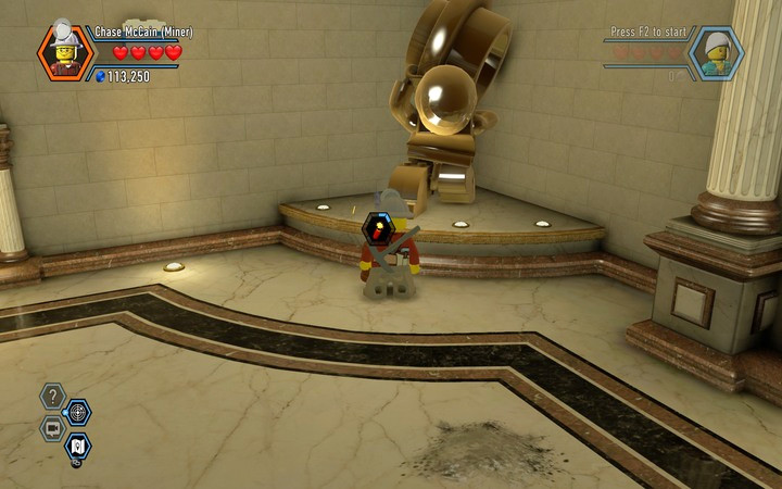 Blow up the statue using the TNT, and you will be able to get behind the second reception - Robbing the gem from the bank | Chapter 6 - Chapter 6 - LEGO City: Undercover Game Guide