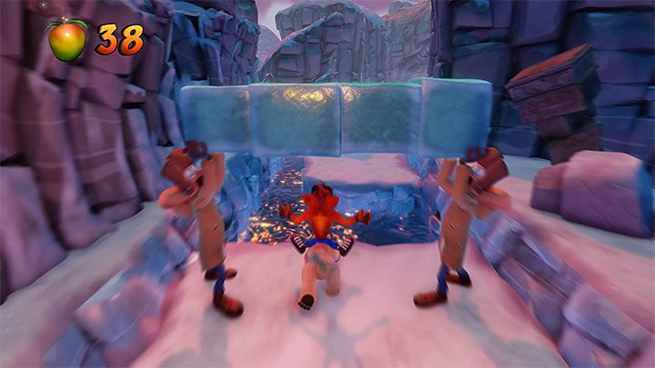 Soon after the ride starts, you will have to jump over a larger reservoir, so make sure that you hold down the jump button and take the jump at the last possible moment - Bear Down | Crash Bandicoot 2 | Levels - Crash Bandicoot 2 - Sewer Warp Room - Crash Bandicoot N. Sane Trilogy Game Guide