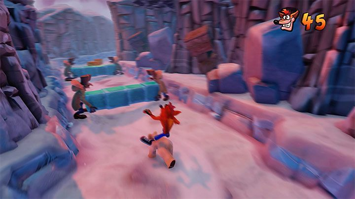 Avoid the seals and another TNT crate on the left - Bear Down | Crash Bandicoot 2 | Levels - Crash Bandicoot 2 - Sewer Warp Room - Crash Bandicoot N. Sane Trilogy Game Guide