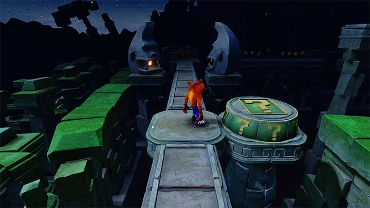 Right past the fire trap, you will find a pressure plate with the question mark shown in the above screenshot - Road to Ruin | Crash Bandicoot 2 | Levels - Crash Bandicoot 2 - Sewer Warp Room - Crash Bandicoot N. Sane Trilogy Game Guide