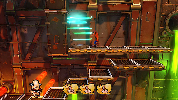 Continue to the right and remember to keep an eye out for more tokens because, at the beginning of this stage, you can also find a Tawnas token and the second Nitrus Brios token - Heavy Machinery | Cortex Island | Levels - Crash Bandicoot - Cortex Island - Crash Bandicoot N. Sane Trilogy Game Guide