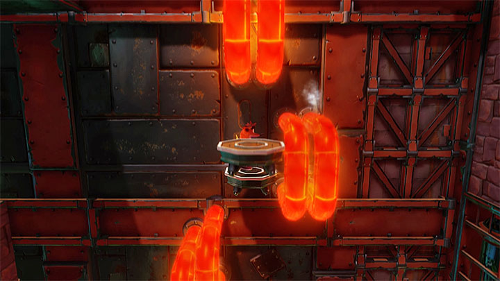 After reaching the small platform you start a new ride to the upper part of the screen during which you must, again, move from one moving platform to another before they get closer to hot pipes - Castle Machinery | Cortex Island | Levels - Crash Bandicoot - Cortex Island - Crash Bandicoot N. Sane Trilogy Game Guide