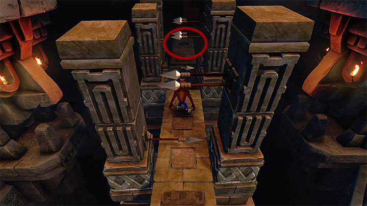 The second token can be found shortly after reaching the location with spears sticking out which is presented in the picture above - Cortexs Terrifying Trial | Crash Bandicoot | Levels - Crash Bandicoot - Crash Bandicoot N. Sane Trilogy Game Guide