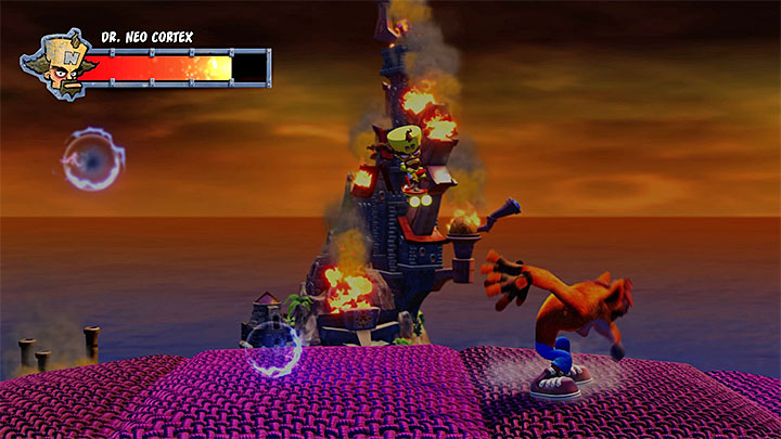 Avoid the slow blue projectiles - Dr. Neo Cortex (final boss) | Boss Fights in Crash Bandicoot - Crash Bandicoot - Crash Bandicoot N. Sane Trilogy Game Guide