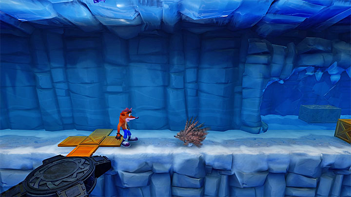 Right after the beginning of the stage, start sliding over ice and, at the right moment, take a jump to avoid the chasm - Snow Biz | Crash Bandicoot 2 | Levels - Crash Bandicoot 2 - Ice Warp Room - Crash Bandicoot N. Sane Trilogy Game Guide